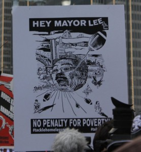 Marches and protests against San Francisco officials' handling of local issues including police brutality and the treatment of those experiencing homelessness. This sign was held during a march held during the Super Bowl game on February 7, 2016.