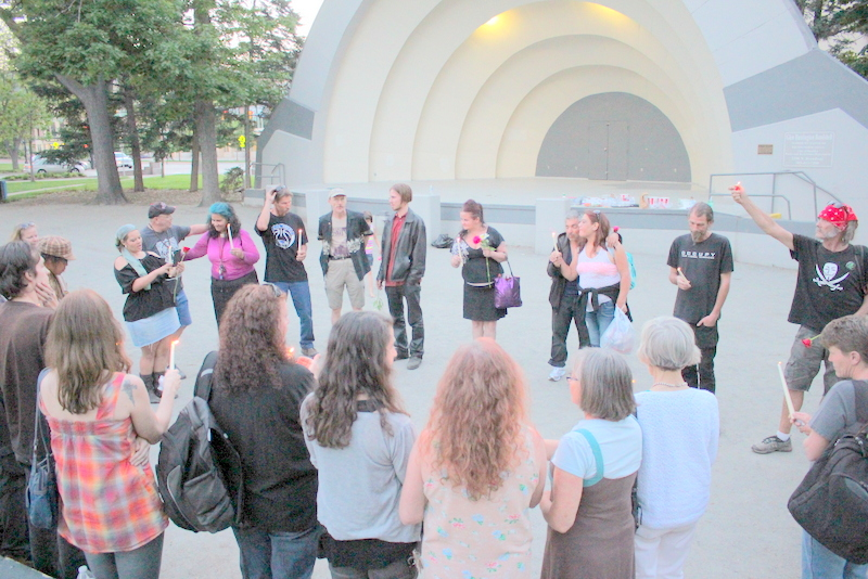 Friends of Nicole Sisneros honor her after her death at a memorial at the Boulder Bandshell in 2015. Sisneros had experienced homelessness in both Boulder and Denver.