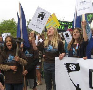 Xiuhtezcatl Martinez (l) and Aerielle Deering (r) march in 2011 in an i-matter march. Both are plaintiffs to the Colorado Court of Appeals.