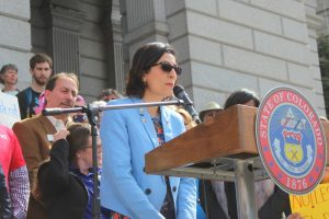 Pantea Beigi speaks at a press conference on the west steps of the Colorado Capitol prior to the hearing of HB-1230.