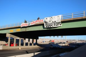 Banners drop over Interstate 25 to mark the one year anniversary of the death of Jessica Hernandez in 2016.