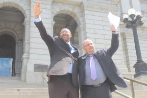 Representatives Jovan Melton (l) and Joe Salazar speak at a rally in support of the Right to Rest Act prior to the bill's reading on April 19, 2107.